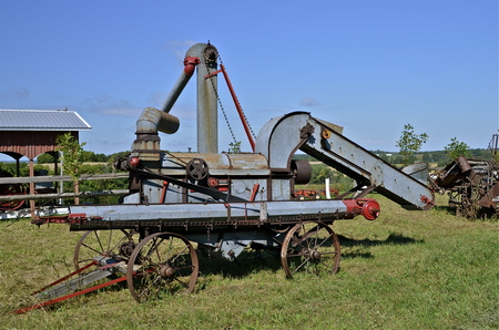 A very old threshing machine brings back old farm memories photo