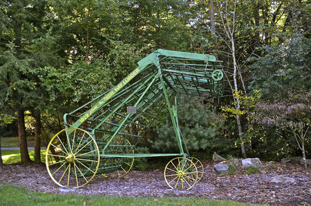 evangelist: ASHEVILLE, NC, September Sept 21: The Cove is a retreat center of the Billy Graham Association and displays a refurbished haywalker near the entrance once used by the Graham family when Billy was in his early years. Editorial