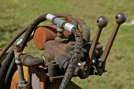 Old levers on a hydraulic pump