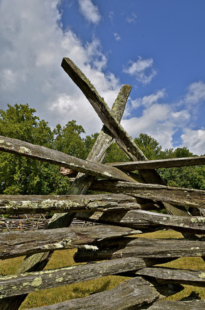 fence post: Braces hold a log fence post together where rails intersect at a corner
