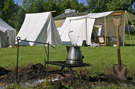 re enactment: A coffee pot is being heated over a grill at a campsite for re-enactment of the military Stock Photo