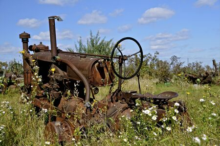 salvage yard: Remains of old tractor in a junk and salvage yard