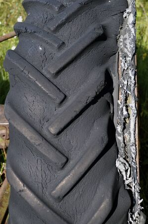 splitting: Rotten old tractor tire splitting at the seams