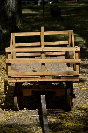 bundles: The sun shines down on a miniature sized rack used for hauling grain bundles for the threshing harvest