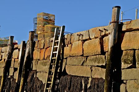 lobster pots: Lobster traps stacked on sea wall in Rockport, Massachusetts
