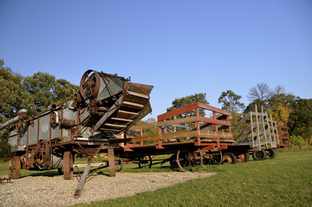 threshing: Threshing machine and wagons of the old fashioned method of harvesting small grain