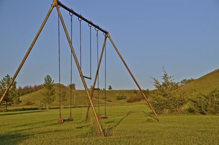 School yard playground swing set with buttes in the background