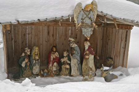 jesus birthday: Nativity scene surrounded by snow banks