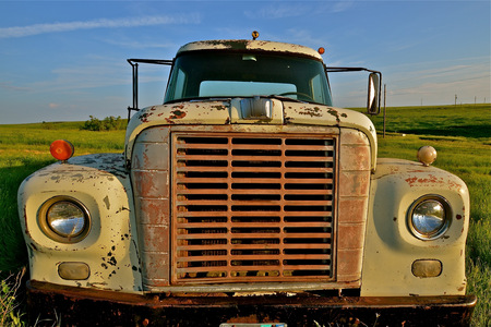 front end: Vintage old non-functional truck left in a pasture Stock Photo