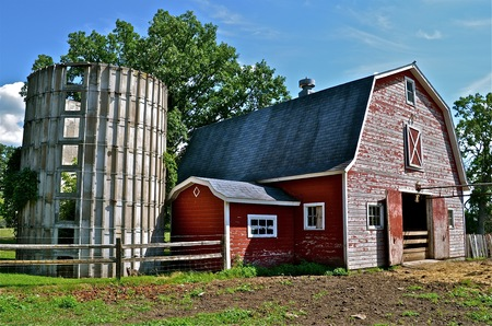 stave: Old dairy farm with traditional red barn and stave silo, Stock Photo