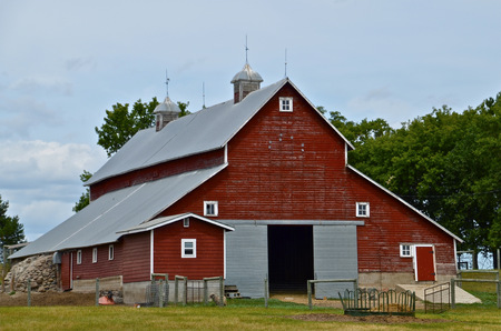 Unique red barn with a cupola on top