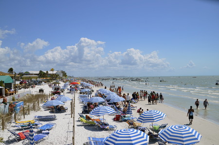myers: FORT MYERS BEACH, FLORIDA:  Vacationers and students enjoy the beautiful beach , warm sunny weather, and white sand.