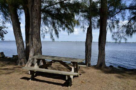 Picnic table along ocean shoreline photo