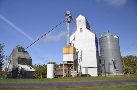 augers: Antiquated rural elevator system with augers and storage bins