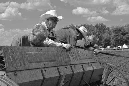 seed drill: FORT SISSETON SD  June 6 2015: Farmers are filling the seed box with oats for planting at the Fort Sisseton Historical Rendezvous in South Dakota where thousands attend the annual festival each first full weekend of June. Editorial