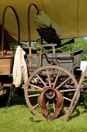 an era: The top has been removed from a covered wagon will of artifacts of the post Civil War era.
