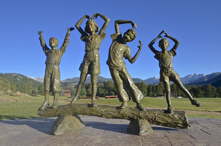 ESTES PARK, COLORADO, June 27, 2015: A statue of The YCMA Kids is on display at the YMCA campground of the Rockies where campers, youth groups, and families gather.