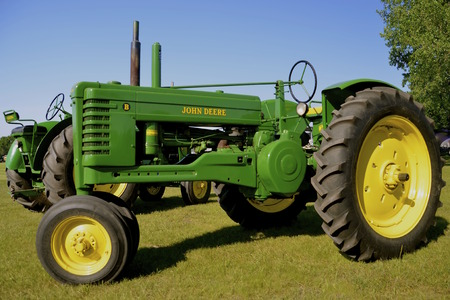 deere: BARNESVILLE, MINNESOTA, July 10, 2015: A restored John Deere B tractor is on display at the Barnesville County Fair in July where thousands attend the annual event.