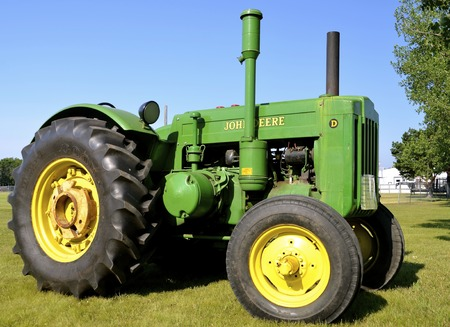 john deere: BARNESVILLE, MINNESOTA, July 10, 2015: A restored John Deere D tractor is on display at the Barnesville County Fair in July where thousands attend the annual event. Editorial