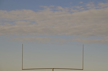 uprights: Football field goal uprights silhouetted in the sky