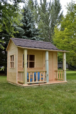 playhouse: Backyard playhouse for a child with a front veranda Stock Photo