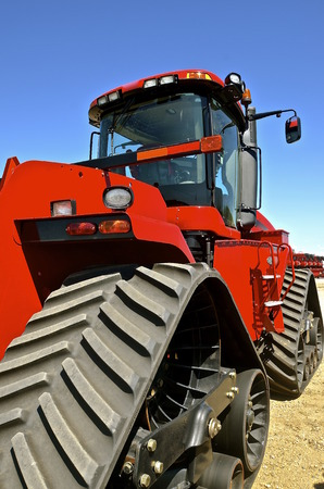 locomotion: A red tractor uses tracks for locomotion rather than wheels Stock Photo