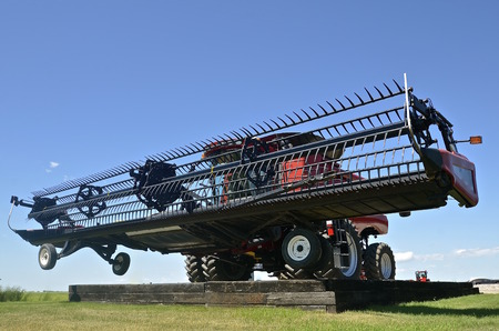 chaff: The header of a self propelled combine appears huge where it rests on a pad for display purposes.