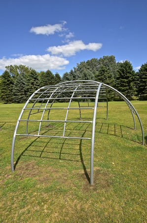 jungle gym: Old jungle gym or monkey bars in a park for kids to climb and play on
