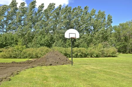 Outdoor basketball site surrounded by excavation and future construction