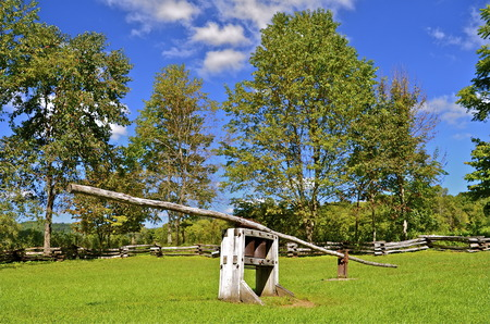 smoky mountains: A rare working sorghum press is displayed at a primitive setting in Cades Cove of the Smoky Mountains, Tennessee. Stock Photo