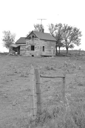 rickety: Rickety old farm home falling into ruins in a pasture