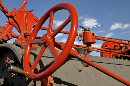 thresh: Brightly red painted steering wheel of a steam engine Stock Photo