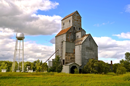 rural town: A small rural town with an abandoned elevator has a water tower nearby.