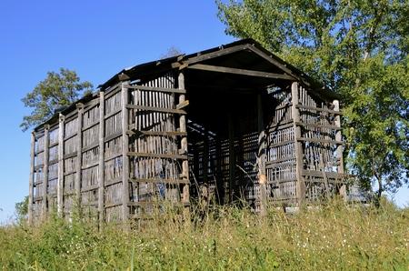 drying corn cobs: Old wood lath corn crib on a farm
