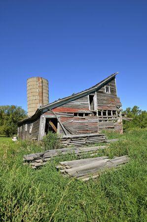 falling apart: Rickety abandoned falling apart old barn