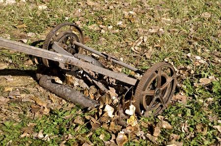 handled: Old wood handled push lawn mower Stock Photo