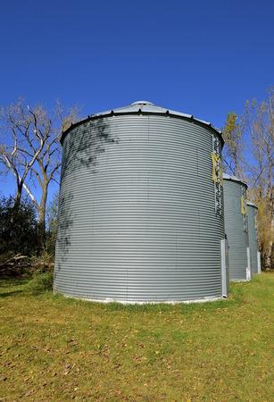 storage bin: Old metal round corrugated steel bin granaries used to store grain and corn