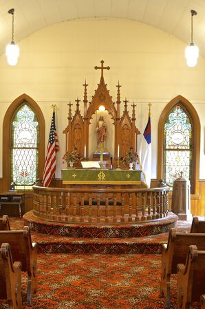 pews: Altar and railing of an old Lutheran church Editorial