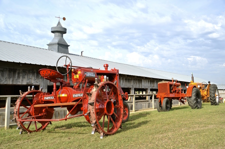 mn: ROLLAG, MN, Sept 10, 2015: A restored F-12 Farmall and Allis Chalmers are displayed at the West Central Steam Threshers ReunionWCSTR where 1000s attend each Labor Day weekend in Rollag, MN each year.