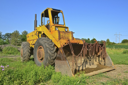 front end loader: Front end loader bucket  with rusty chains hanging