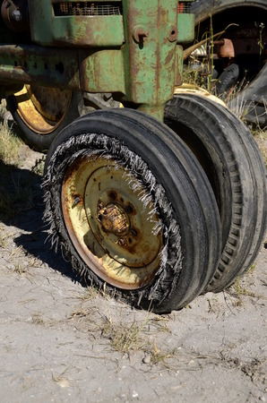wornout: Old tractor with flat worn-out tires