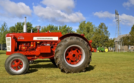 thresh: DALTON, MINNESOTA, September 10, 2015: A W-450 International Farmall tractor is displayed at the annual Dalton Threshing reunion held each 2nd weekend of September which thousands attend .