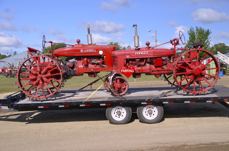 restored: ROLLAG, MN, Sept 6, 2015: Old restored Farmall tractors arrive at the West Central Steam Threshers ReunionWCSTR where 1000s attend each Labor Day weekend in Rollag, MN each year. Editorial