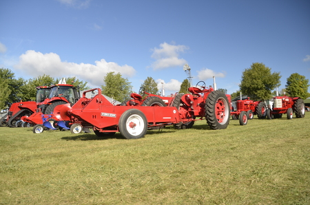 refurbished: DALTON, MINNESOTA, September 10, 2015:  Farmall tractors and a manure spreader is displayed at the annual Dalton Threshing reunion held each 2nd weekend of September which thousands attend . Editorial
