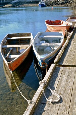 lobster boat: Wooden row boats tied to a floating dock at Cape Ann in Rockport, Massachusetts Stock Photo