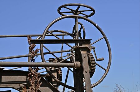 The gears and wheels of an old vintage road grader.