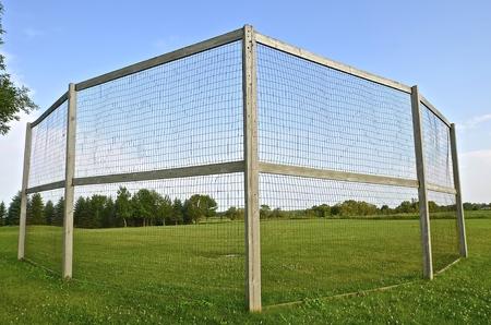backstop: Neighborhood homemade backstop for baseball or softball in the corner of a field Stock Photo