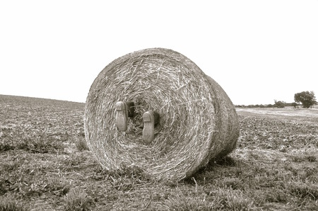 wrapped up: The farm boots of a an apparent body wrapped up in a huge round bale