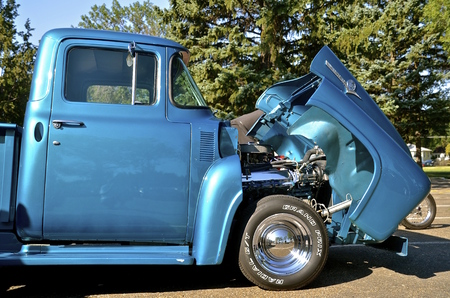 BISMARCK, NORTH DAKOTA, August 1,2015: A classic old Ford pickup has hood retracted a the Fords and Mustangs of the Dakotas held annually at the Capital Afaire each first full weekend of August