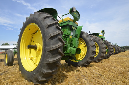 deere: ROSHOLT, SOUTH DAKOTA-August 15, 2015: The Rosholt Area Threshing association holds its annual threshing reunion the 3rd weekend of August where owners have the opportunity to display and line up their old John Deere tractors.